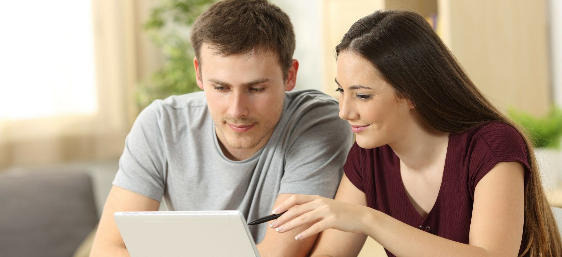 Male and Female at computer looking at finance application